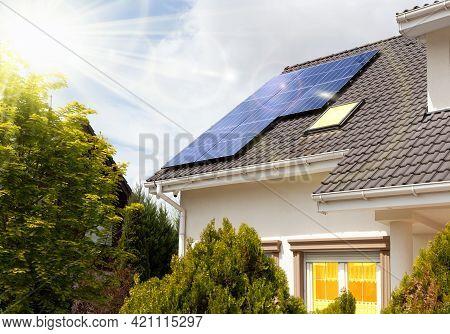 Solar Panels On A Gable Roof. Beautiful Modern House And Solar Energy.