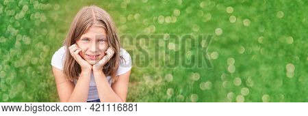 Little Girl Portrait. Outdoor Green Background. Looking. Teenager Schoolgirl At Park. Cute Face. Chi