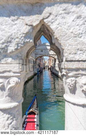 Sighs Bridge With Gondolas And White Stone Arch In Foreground. Venice, Italy. High Quality Photo