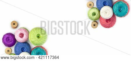 Multicolored Balls And Bobbins Of Woolen Yarn, Wooden Thread Sleeves On White Isolated Background. B