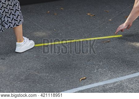 People Making Social Distancing Marker Strips On Road For Safe Street Food Festival. Yellow Line On