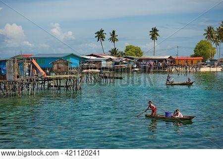 Semporna. Malaysia. December 01, 2018. The Children Of The Sea Gypsy Village Artfully Swim In Boats