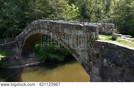 Stone Archway Bridge Over The River Esk In England.