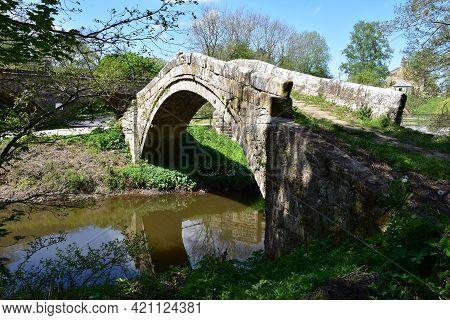 Medieval Beggar's Bridge Over The River Esk In Glaisdale England.