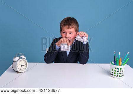 Junior Boy In School Uniform With Dollar And Us Money Torn In Half On Blue Background