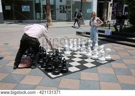May 14, 2021 Santa Monica California, USA: People play a Giant Chess Board outdoors. Chess is enjoyed world wide by various people. Editorial Use Only.
