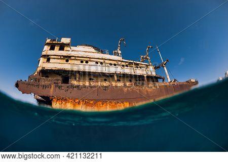 Old Wreck Ship In Blue Ocean In Arrecife, Lanzarote. Split Shot.
