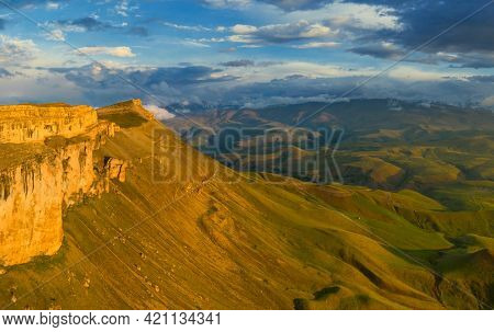 Aerial view of plateau Bermamyt and hills at sunset, North Caucasus mountains, Russia.