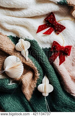 Christmas ornaments on a knitted blanket
