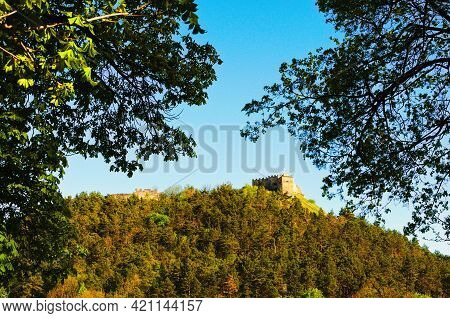 Landscape View Of Ruins Of Ancient Kremenets Castle On The Top Of The Hill. Tree Leaves Border. Natu