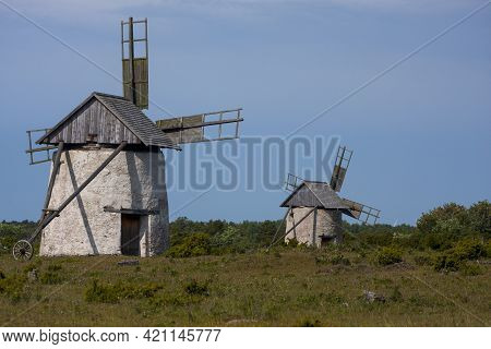 Two Old  Dutch Type Windmills On The Field In Countryside Of Gotland Island, Sweden, Europe
