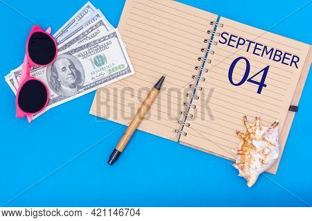 4th Day Of September. Travel Concept Flat Lay - Notepad With The Date Of 4 September Pen, Glasses, D