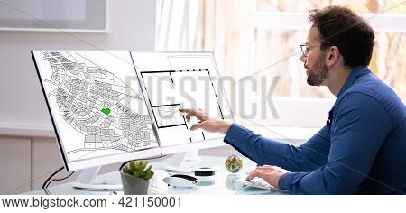 Developer Looking At Land Plot Map And Cadastre Plan
