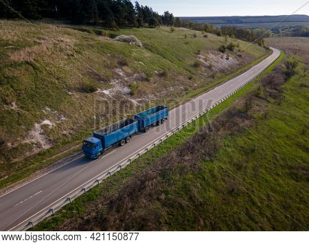 Moscow , Russia - SPT 27, 2020:   Blue tipper truck on street road highway transportation aerial