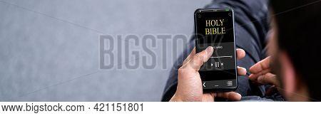 Bible Praying Audiobook On Phone. Listening And Praying