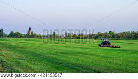 A Typical Roller Mower Operating On A Sod Grass Farm.
