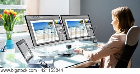 Woman Working On Computer Monitors Making Graphic Web Design