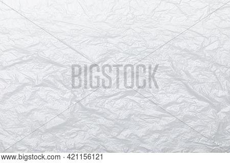 Wrinkled polyethylene plastic wrap on white background