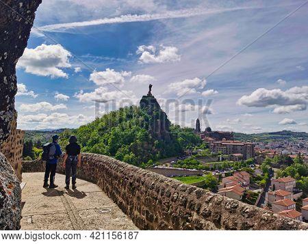 Pilgrims Looking At The Magnificent View Over Le Puy En Velay, Departure Of The Camino De Santiago.