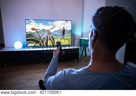 Man Watching Live Tv In Room. Streaming Television