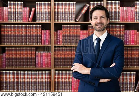 Male Attorney With Arms Crossed. Lawyer In Office