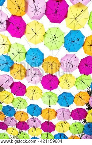 Vertical Overhead Shot Of A Collection Of Colorful Umbrellas.