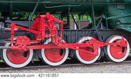 Red And White Iron Wheel Set With Coupling Rod (side Rod) Of The Old Retro Steam Locomotive Close Up