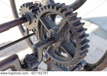 A Part Of An Old Well Mechanism Machine With Sprocket Wheels Made Of Wrought Iron Close Up Detail