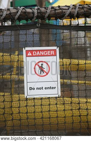 May 14, 2021 Santa Monica California, USA: Danger do not enter sign. A Do Not Enter Sign on the side of a fence at an amusement park.