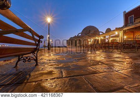 Old Venetian Port Xania Creta Greece Towards To The Lighthouse In Twilight, A Bench Restaurants Anci