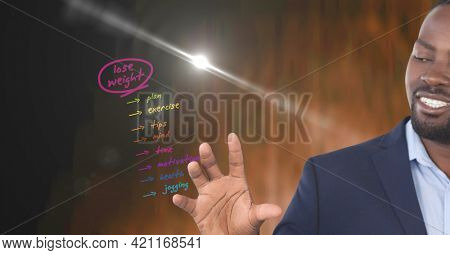 Composition of smiling man using virtual interface with lose weight health list menu. global communication, health and digital interface concept digitally generated image.