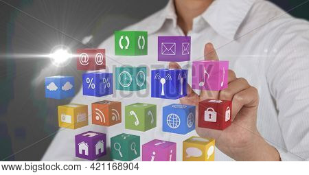 Composition of businessman touching screen with digital colourful icons. global communication, technology and digital interface concept digitally generated image.