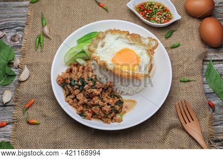 Thai Stir Fried  Basil With Minced Pork, Chili And Fried Egg On Topped Rice. Thai Local Food Style C