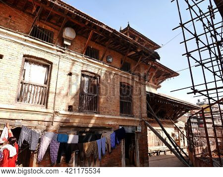 Nepalese Workers People Renovate Repair And Build Scaffolding Structure At Ancient Ruins Antique Bui