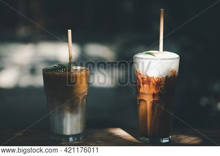 Iced Latte Coffee And Iced Mocha In Glasses With Straws On Wooden Table. Summer Cold Refreshing Drin