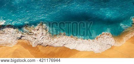 Aerial View Of Blue Ocean Waves In Kelingking Beach, Nusa Penida Island In Indonesia. Beautiful Sand