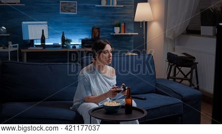 Focused Determined Woman Playing Video Game Late Night Concentrated Trying To Win Online Competition