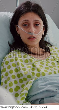 Sick Patient Lying In Bed Talking With Practitioner Doctor Explaining Disease Symptom. Medic Special