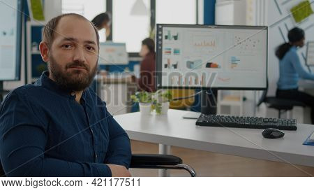 Paralized, Invalid, Handicapped Office Manager Looking At Camera Sitting In Modern Startup Company O