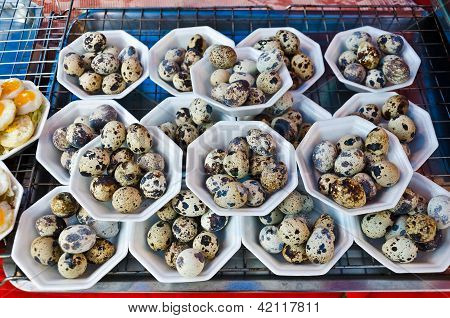 Boil Quail's egg selling at outdoor market in Thailand. poster