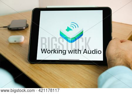 Apple Working With Audio Logo On The Screen Of Ipad Tablet. March 2021, San Francisco, Usa