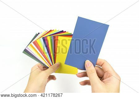 Color Palette Samples In Hand On White Background. Rainbow Sample Colors Catalogue