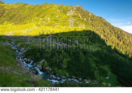 Balea Stream Of Fagaras Mountains. Wonderful Summer Scenery In The Morning. Popular Travel Destinati