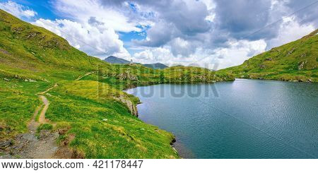 Summer Landscape With Lake On High Altitude. Beautiful Scenery Of Fagaras Mountain Ridge In Summer.