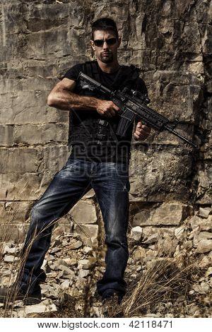 Menacing Man With A Machine Gun