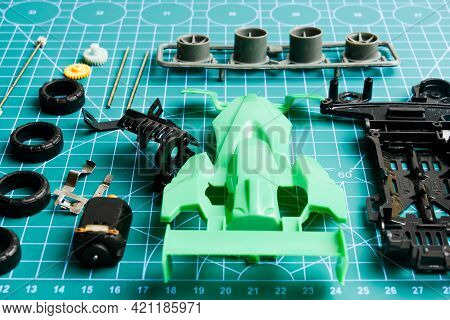 Mini 4wd Toy Car Awaiting To Be Assemble On Cutting Mat. Popular Toy Car During 90's.