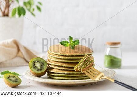 Green Matcha Pancakes With Matcha Tea Or Spinach. Healthy Breakfast With Superfoods. Light Backgroun