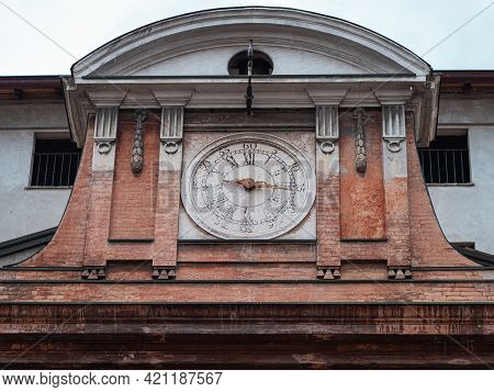 Antique Clock With Roman Numerals Placed On The Old Hospital Building In Parma, Italy.