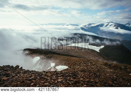 Atmospheric Scenery On Top Of Mountain Ridge Above Thick Low Clouds. Scenic View From Precipice Edge