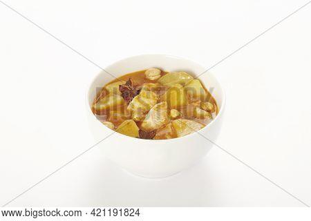 A Chicken Massaman Curry In White Bowl Isolated On White Background. Massaman Curry Is Thai Cuisine